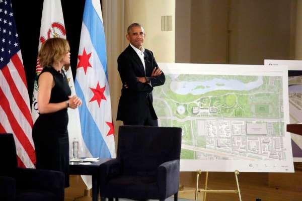 President Obama with Architect Dina Griffin with architectural drawings