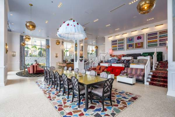 Eccentric, colorful dining area with design accents