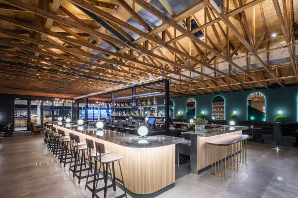 Restaurant bar with wood beams and bar seating