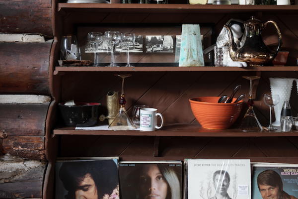 Dark wood shelving with vintage interior design decor