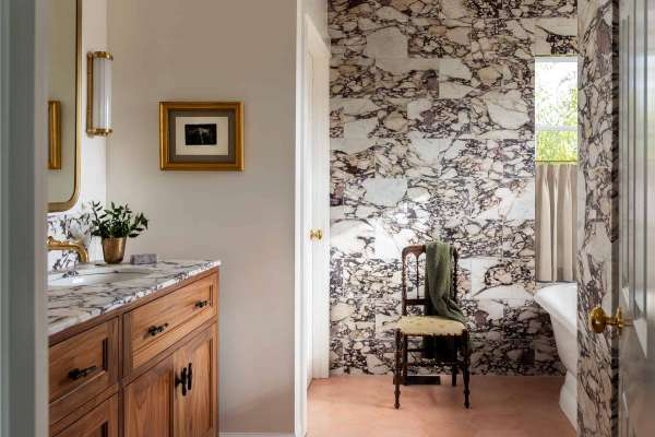 Bathroom with marble patterned wallpaper
