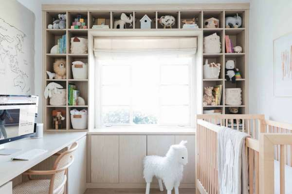 Bright nursery design with rocking horse and crib