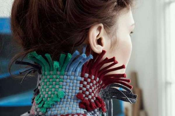 Fashionable jewel toned knit jacket on woman with brown hair in a bun