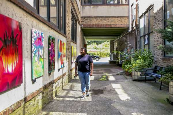 Fresh Artists' student exploring the alleyway gallery