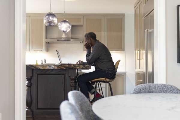 Chris Heard sitting at his kitchen bar at home in Atlanta, GA
