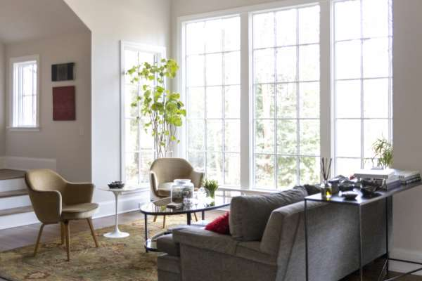 Chris Heard's home, with light coming through large windows across living room furniture
