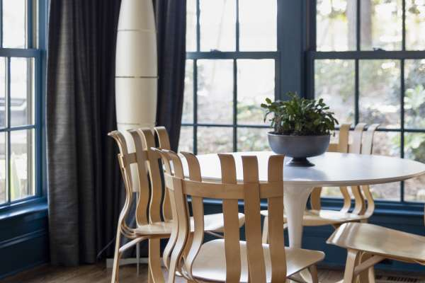 Small dining area with wooden chairs in Chris Heard's home