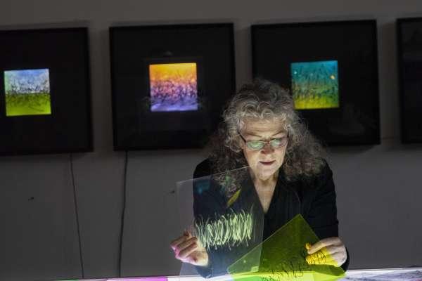 Lyn Godley working on light artwork in her studio