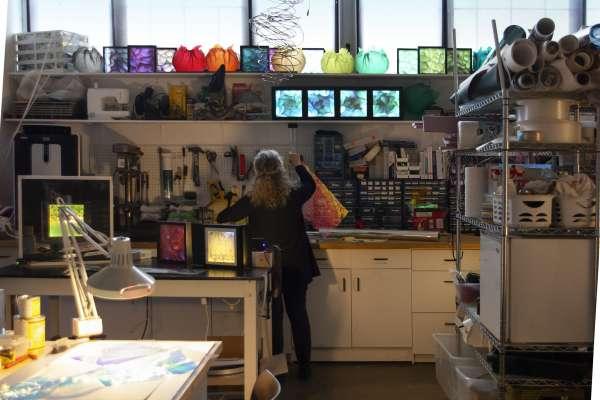 Lyn Godley working in her studio on light-artwork