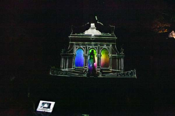 Light art exhibit on cathedral sculpture