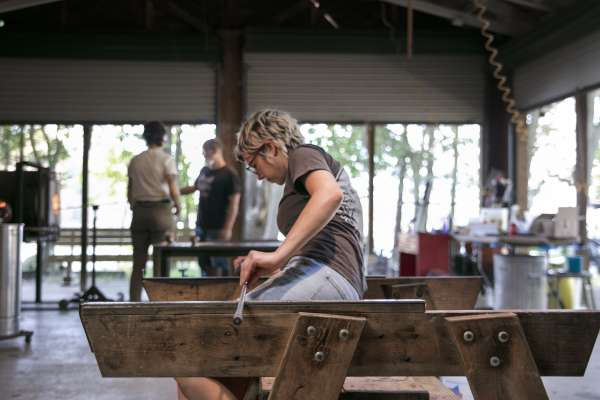 Student blowing glass art at Ox-Bow school of art in Michigan