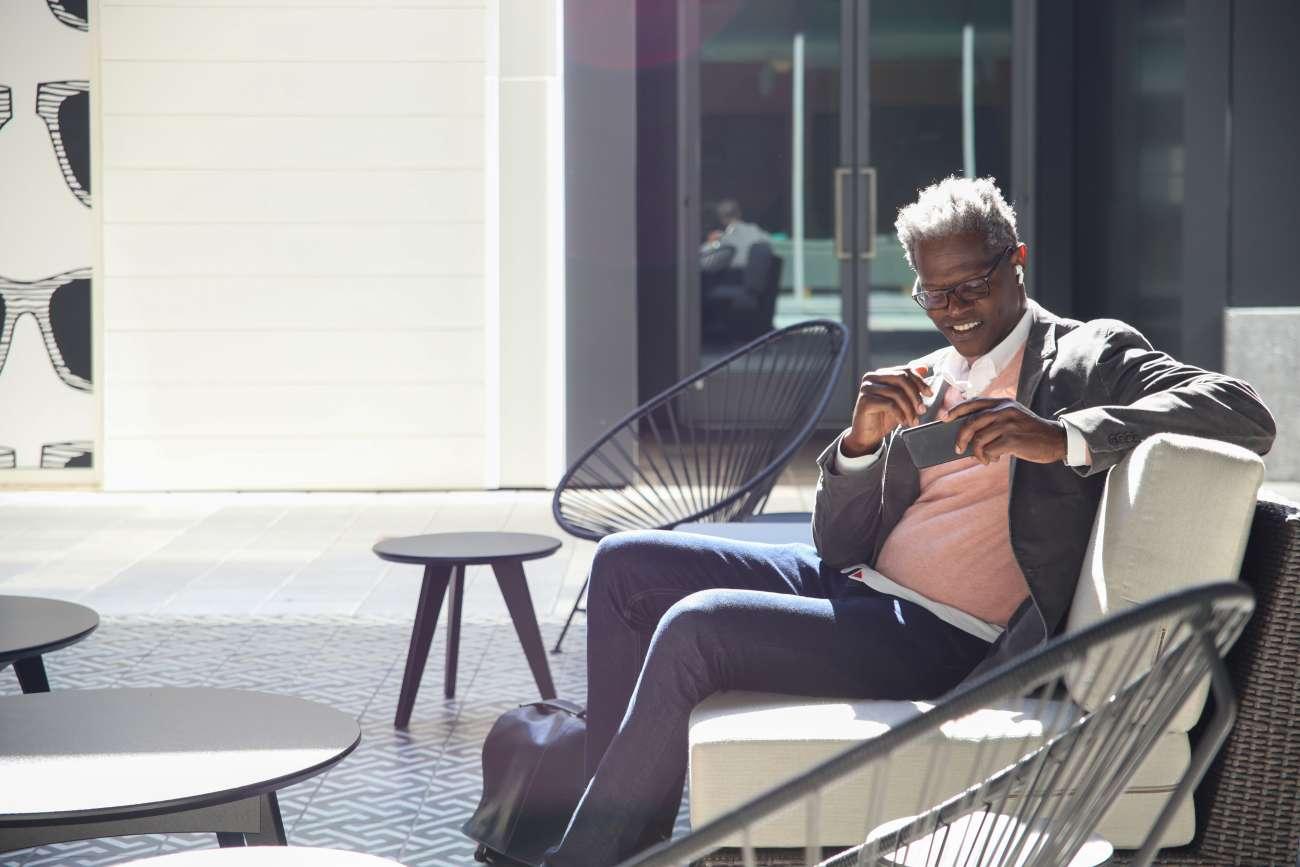 Chris Heard sitting in an outside patio in Atlanta, GA