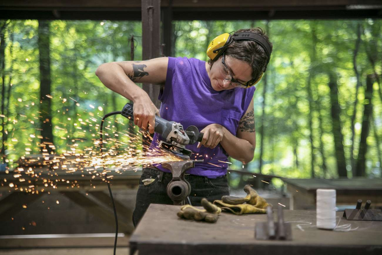 Student at Ox-Bow working on metalworking art project