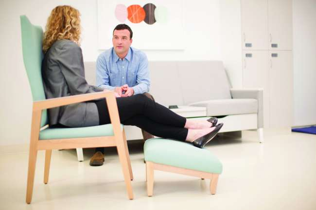 Rein+ and Wood Patient Ottoman